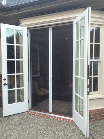 Practical french doors and the screens that love them for Back door with window that opens